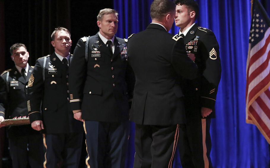 Army Lt. Gen. Austin S. Miller, the chief of Joint Special Operations Command, pins the Silver Star Medal on Staff Sgt. Michael Young on Friday. Young was honored for his actions as a Ranger weapons squad leader during a firefight in eastern Afghanistan in April 2017.