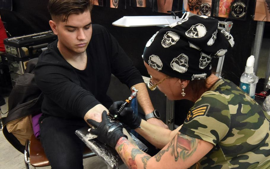 Pvt. Peter Bower, an infantry soldier with the 2nd Cavalry Regiment, gets an ancient Germanic symbol tattooed on his forearm at the Tattoo Expo Grafenwoehr, in Grafenwoehr, Germany, Sunday, April 15, 2018.