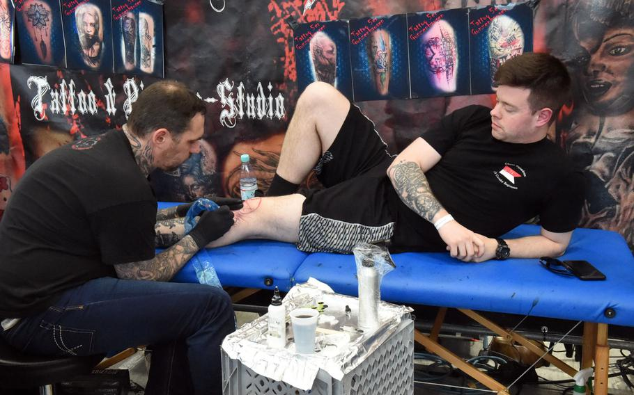 Sgt. Kevin Deerwester, an infantryman with the 2nd Cavalry Regiment, gets a skull tattooed on his knee at the Tattoo Expo Grafenwoehr, in Grafenwoehr, Germany, Sunday, April 15, 2018.