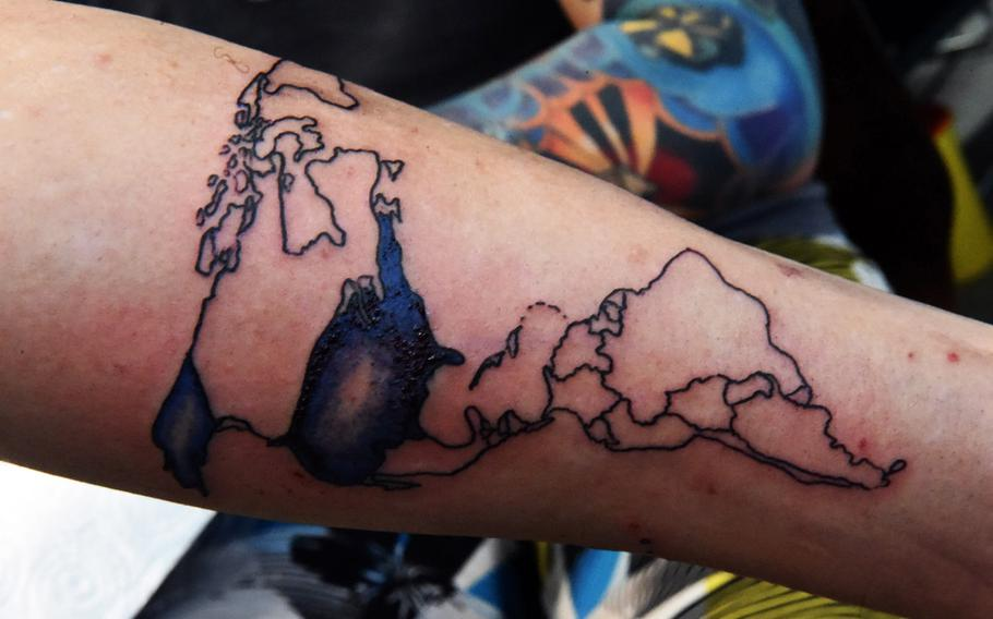 Spc. Marcus Sheppard, a military policeman at U.S. Army Garrison Bavaria, shows his in-progress tattoo of a map of the world, at the Tattoo Expo Grafenwoehr, in Grafenwoehr, Germany, Sunday, April 15, 2018. Taylor ended up winning best color tattoo.