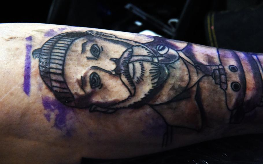 """Sgt. Carlos Aizaga, a paratrooper with the 173rd Infantry Brigade Combat Team (Airborne) shows his in-progress tattoo of Steve Zissou, from the movie """"The Life Aquatic with Steve Zissou,"""" at the Tattoo Expo Grafenwoehr, in Grafenwoehr, Germany on Sunday, April 15, 2018. Taylor ended up winning best color tattoo."""