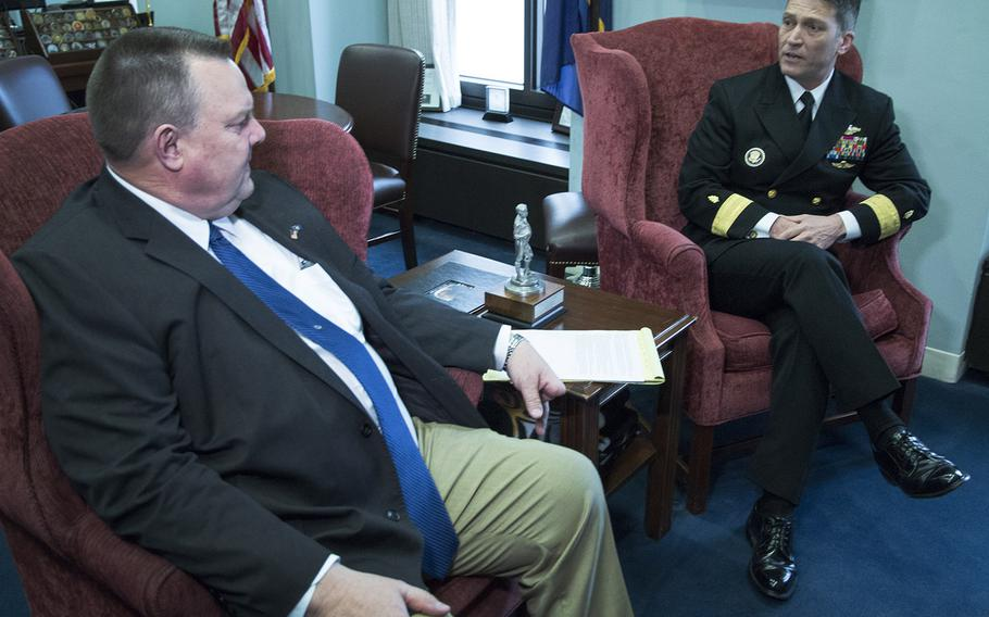 Rear Adm. Ronny Jackson, President Donald Trump's nominee to succeed David Shulkin as Secretary of Veterans Affairs, talks with Senate Veterans' Affairs Committee Ranking Member Jon Tester, D-Mont., in Tester's Capitol Hill office, April 17, 2018.