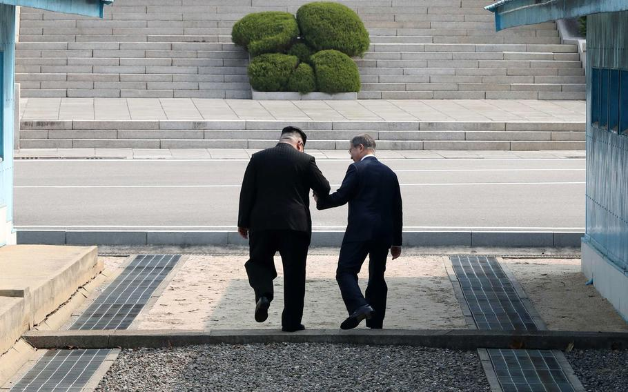 North Korean leader Kim Jong Un shakes hands with South Korean President Moon Jae-in Friday, April 27, 2018 as the two leaders began a historic summit aimed at ridding the communist state of its nuclear weapons.