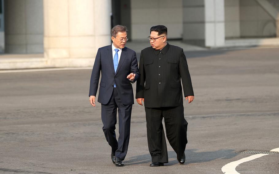 North Korean leader Kim Jong Un, right, walks with South Korean President Moon Jae-in during the Inter-Korean Summit on Friday, April 27, 2018.