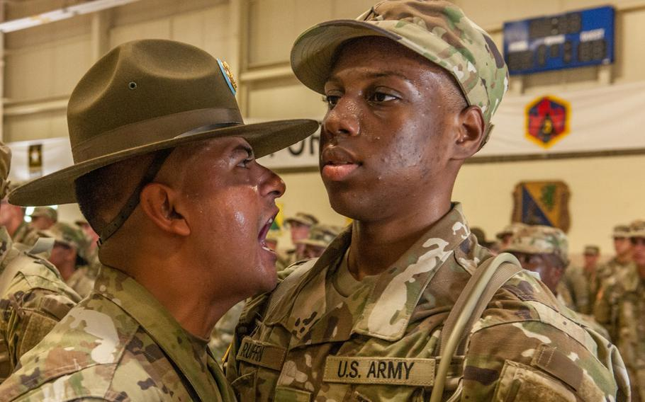 A drill sergeant with Company A, 2nd Battalion, 48th Infantry Regiment, welcomes a new soldier to Fort Leonard Wood in 2017.
