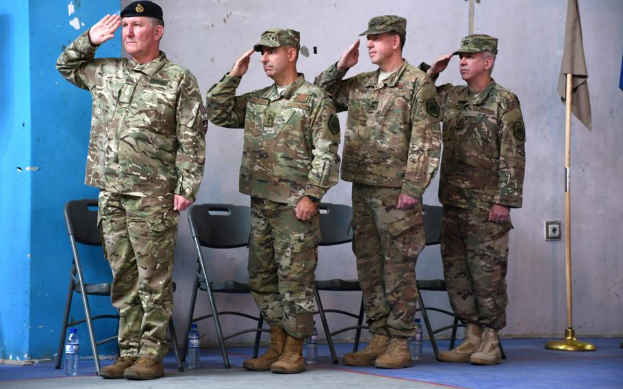 Top officials salute during a ceremony in Kabul for Air Force Maj. Gen. Barre R. Seguin, incoming commander for NATO Air Command-Afghanistan, on Wednesday, May 2, 2018. From left, British Army Lt. Gen. Richard Cripwell, deputy commander of NATO's Resolute Support mission;  Lt. Gen. Jeffrey L. Harrigian, head of U.S. Air Forces Central Command; outgoing commander Maj. Gen. James B. Hecker; and Seguin.