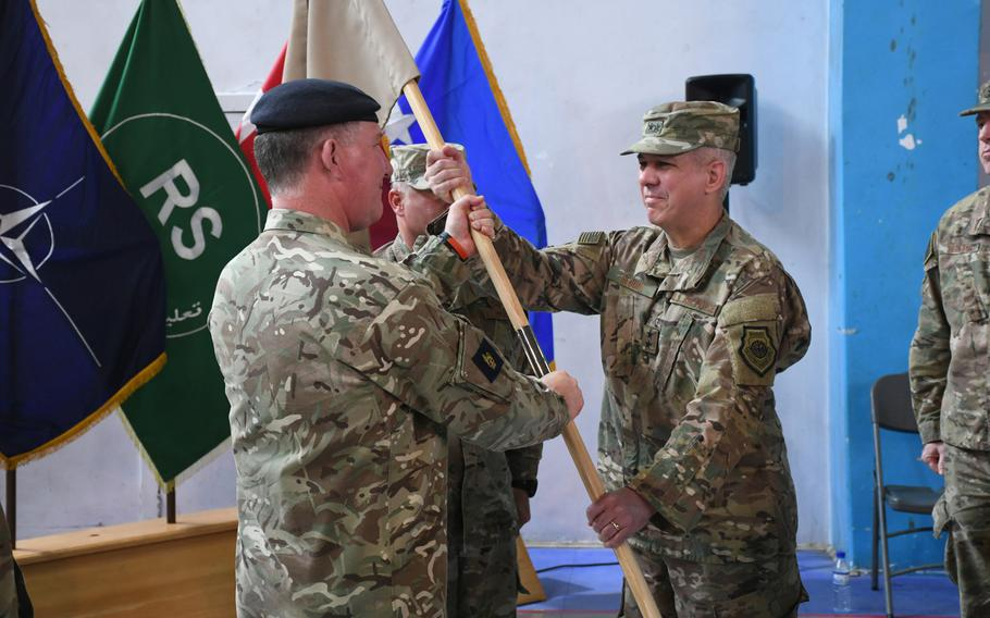 Air Force Maj. Gen. Barre R. Seguin, right, assumes command of the 9th Air and Space Expeditionary Task Force-Afghanistan and NATO Air Command-Afghanistan from British Army Lt. Gen. Richard Cripwell, deputy commander of NATO's Resolute Support mission, at a ceremony in Kabul on May 2, 2018.