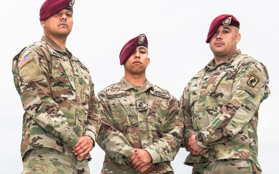 Spc. Avelardo Martinez, Pfc. Christopher Ortiz and Spc. Joey Biggers pose for a portrait outside of the Caserma Ederle gynmasium on May 4, just hours before learning that their team had won the BOSS Strong Challenge.