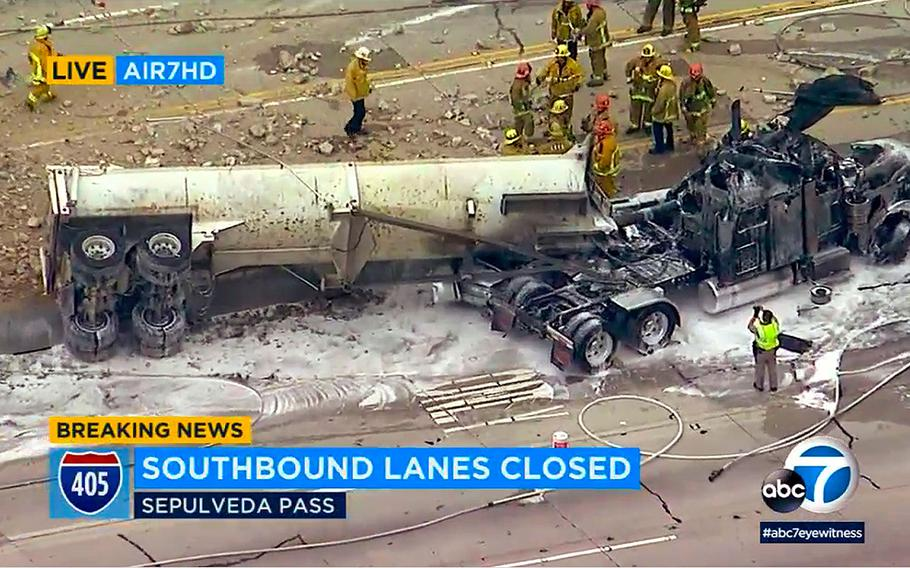 Emergency crews work around the wreckage on southbound Interstate 405 near the Mulholland Bridge on the west side of Los Angeles Monday, April 30, 2018.  The fiery crash injured three people, two critically.
