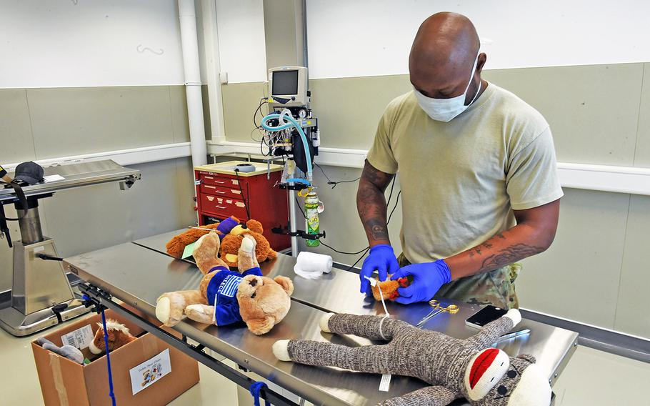 Veterinarian technician Spc. Michael Simmons operates on a stuffed animal at the base animal hospital in Vilseck, Germany, Monday, May 7, 2018.