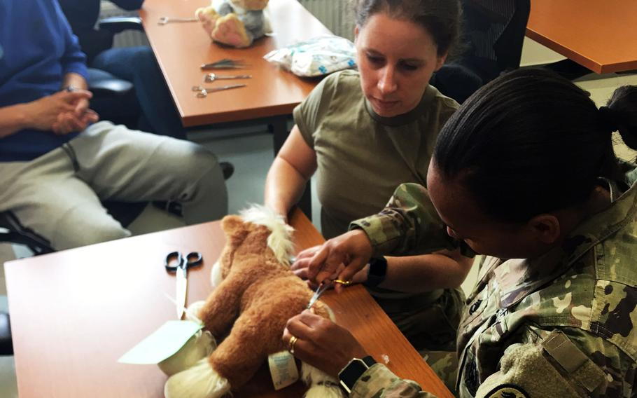Base veterinarians operate on a stuffed horse at the base animal hospital in Vilseck, Germany.
