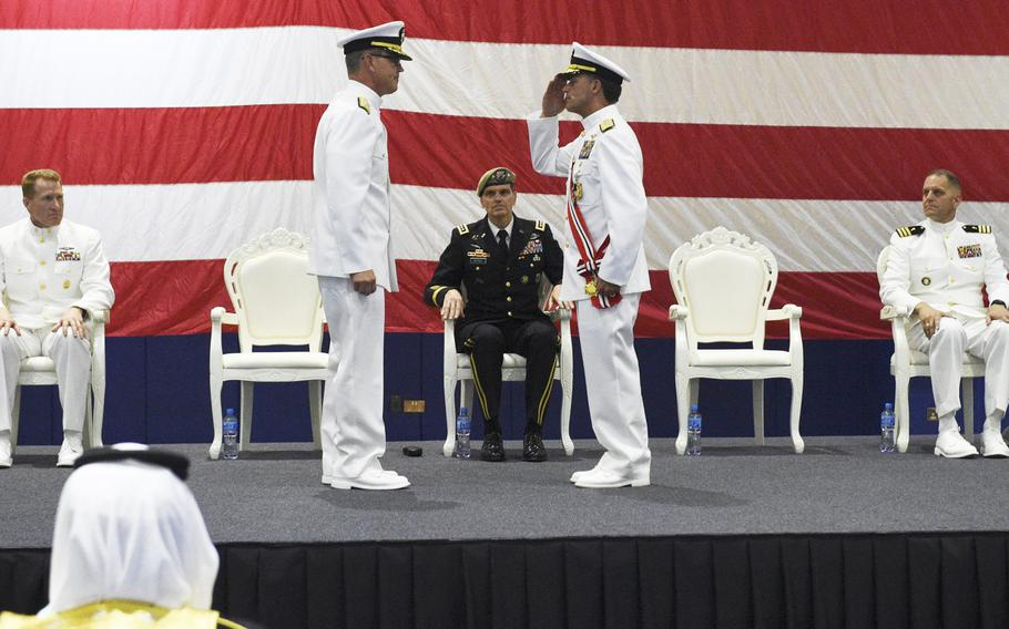 Vice Adm. John Aquilino salutes Vice Admiral Scott Stearney at a change of command ceremony in Manama, Bahrain, May 6, 2018. Stearney relieved Aquilino for command of U.S. 5th Fleet and Naval Forces Central Command.
