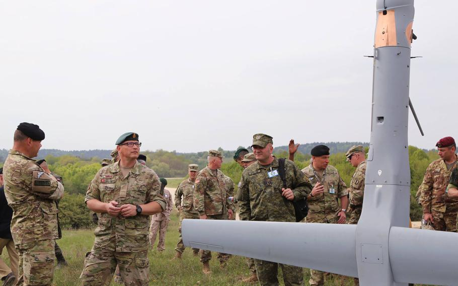 Visitors look at the Martin Unmanned Aerial Vehicle V-BAT, Hohenfels, Germany, May 3, 2018. Various military and civilian officials came to Hohenfels to see how the Joint Warfighting Assessment 18 assesses solutions to warfighting challenges.
