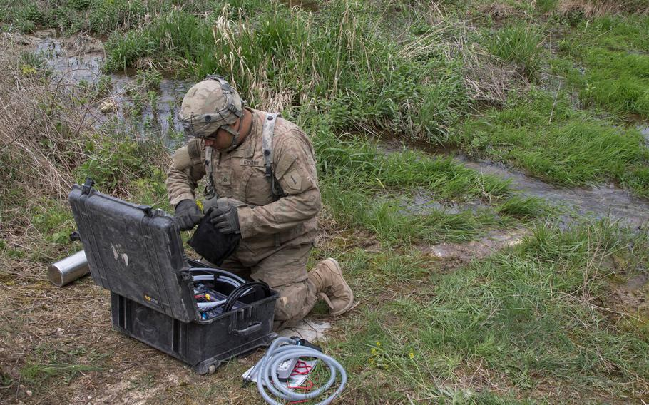 U.S. Army Pfc. Jacob Rogers, a tank gunner assigned to 2nd Armored Brigade Combat Team, 1st Infantry Division, Fort Riley, Kan., sets up a Versa Pak water purification system for testing during Combined Resolve 10 at the Hohenfels Training Area, Germany, May 2, 2018.