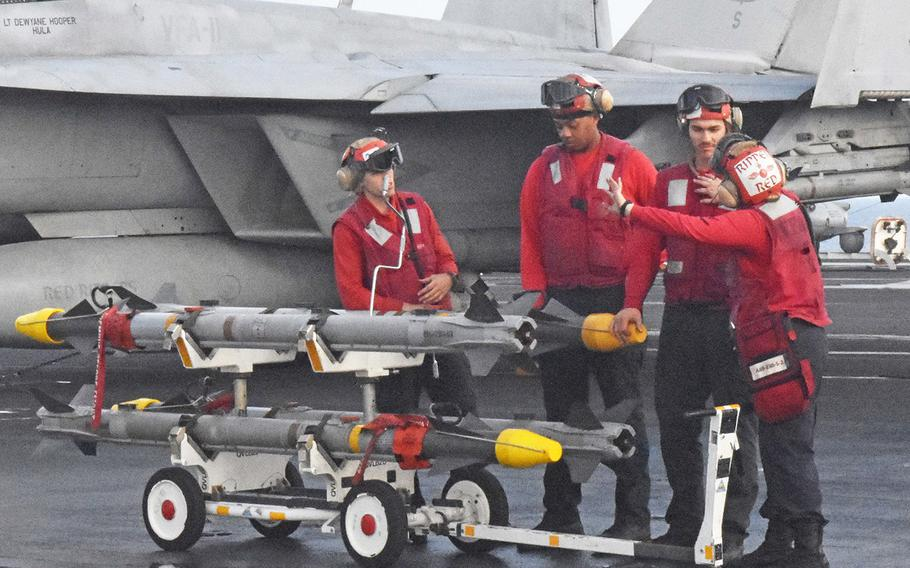 Crew members prepare to move ordnance for an FA-18 Super Hornet aboard the USS Harry S. Truman on May 8, 2018. The Truman is in the eastern Mediterranean launching air strikes against the Islamic State.