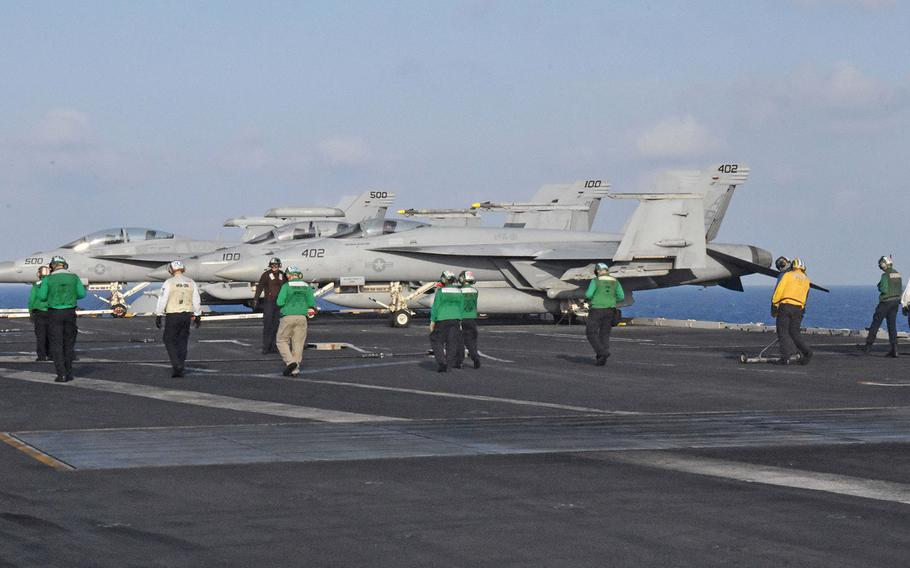 Crews check the USS Harry S. Truman's entire flight deck for loose debris that could be sucked into the FA-18 Super Hornets' internal systems and cause severe damage.The Truman is deployed to the eastern Mediterranean to launch air strikes against the Islamic State.
