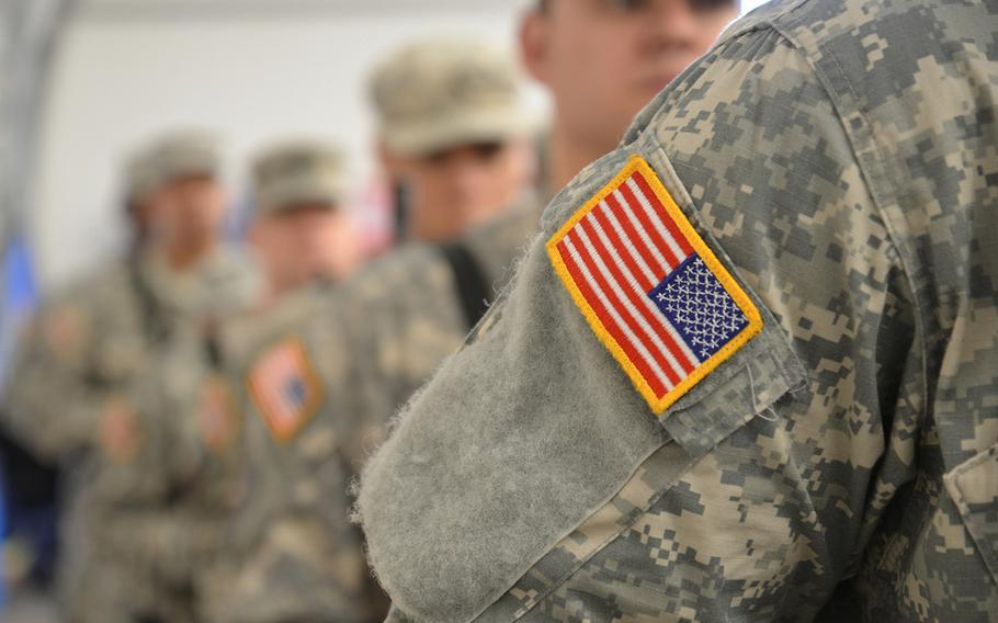 Soldiers stand in formation during a deployment ceremony for an Army Reserve battalion in 2016. The Army, after doling out housing allowances to a group of reservists deployed to Germany, said they were not entitled to the allowances.
