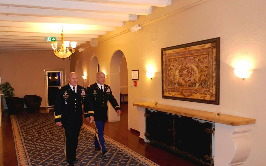 Maj. Gen. Roger Cloutier, U.S. Africa Command's chief of staff, left, walks with Col. Richard Gulley during Gulley's June 30, 2017, retirement ceremony in Stuttgart, Germany. Gulley, along with numerous other reservists, says he was unfairly targeted by Army investigators over housing benefits.