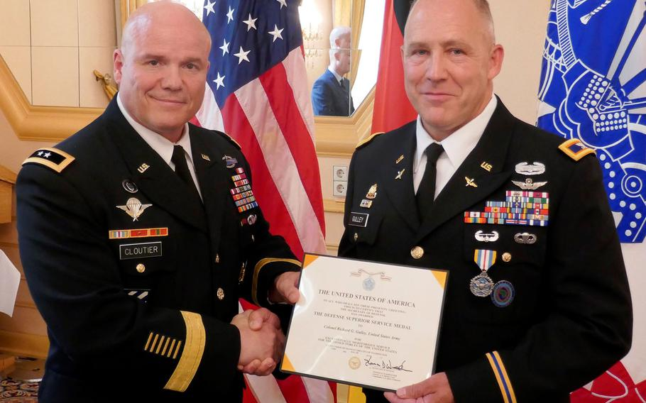 Maj. Gen. Roger Cloutier, U.S. Africa Command's chief of staff, left, stands with Col. Richard Gulley during Gulley's retirement ceremony in Stuttgart, Germany, on June 30, 2017. Gulley, along with numerous other reservists, says he was unfairly targeted by Army investigators over housing benefits.