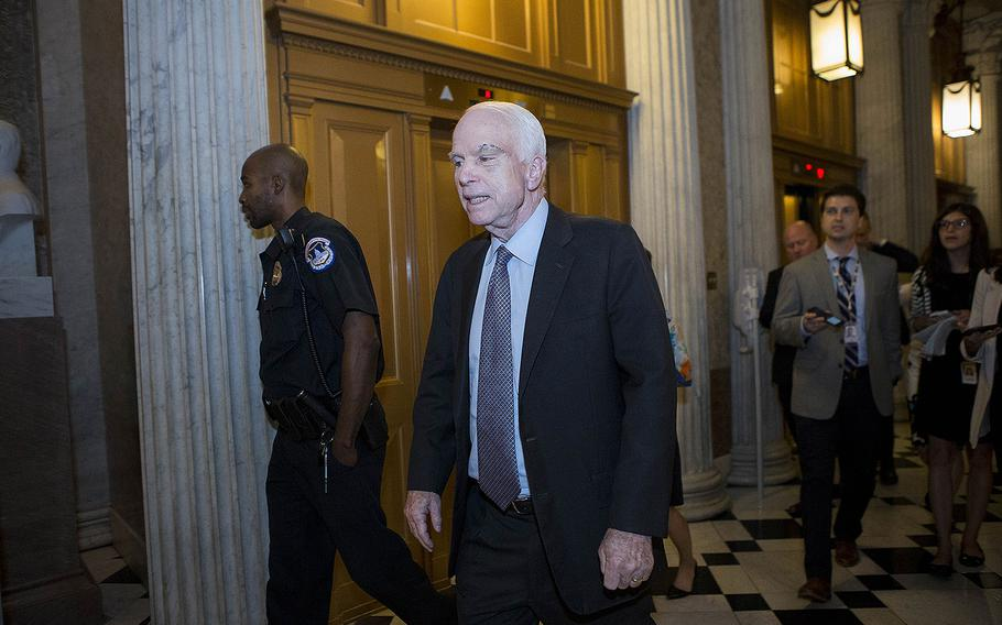 """Sen. John McCain, R-Ariz., walks to the Senate chamber on July 28, 2017, prior to voting on a bill that would have repealed the Affordable Care Act. Filming for the upcoming HBO documentary, """"John McCain: For Whom the Bell Tolls,"""" began the same month, shortly after he was diagnosed with glioblastoma, an aggressive form of brain cancer."""