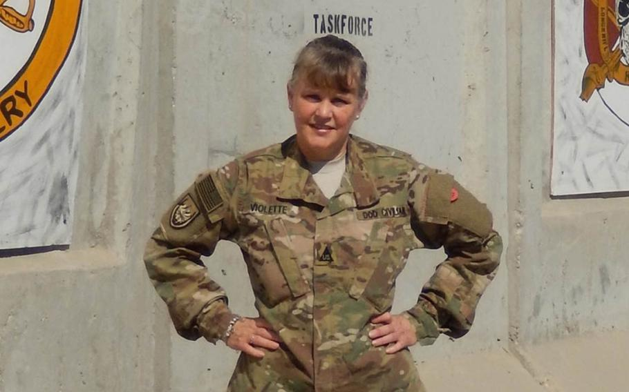 Chanteen Violette, shown here during her deployment to Afghanistan, was considered eligible for living quarters allowance under Army regulations when she accepted her job. But new Army guidance determined that she isn't eligible for LQA.