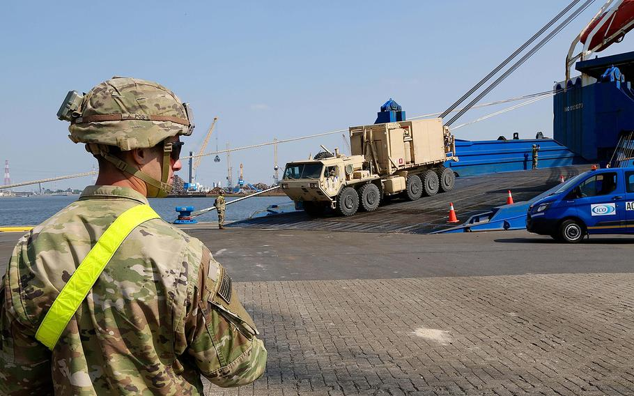 A soldier from the 1st Armored Brigade Combat Team, 1st Cavalry Division, waits for an opening on the receiving line for vehicles leaving the cargo ship Endurance in Antwerp, Belgium, Sunday, May 20, 2018. The soldier pictured is part of a 3,500-person force deployed to Europe for nine months in support of Atlantic Resolve.   Will Morris/Stars and Stripes