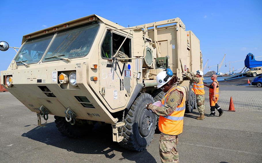A soldier checks off a truck from an inventory of vehicles transported aboard the cargo vessel Endurance, Sunday, May 20, 2018. The truck was one of some 976 vehicles that are being offloaded at Antwerp, Belgium in support of Atlantic Resolve.