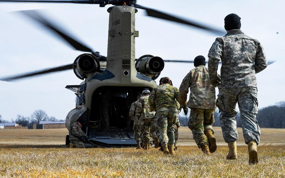 In a February 13, 2017 file photo, soldiers with the 101st Combat Aviation Brigade, 101st Airborne Division (Air Assault) load equipment into a CH-47 Chinook helicopter in preparation to jump their tactical operations center to a new location during Warfighter, a two-week command and control exercise at Ft. Campbell, Ky.