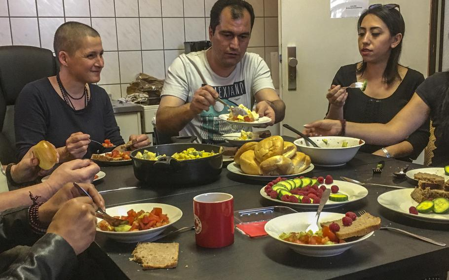 Red Cross psychologist Susanne Sage, left, her patient Farshid Salawti, center, and a translator eat dinner after a counseling sessions in Kaiserslautern, Germany, on April 19, 2018. Salawti, an Iranian migrant, is an asylum-seeker who is one of 60 to 80 patients seen by Sage since the fall of last year.