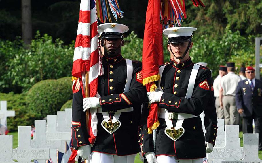 The Marine color guard marches through Aisne-Marne American Cemetery in Belleau France, prior to the Memorial Day and World War I centennial commemoration, Sunday, May 27, 2018.