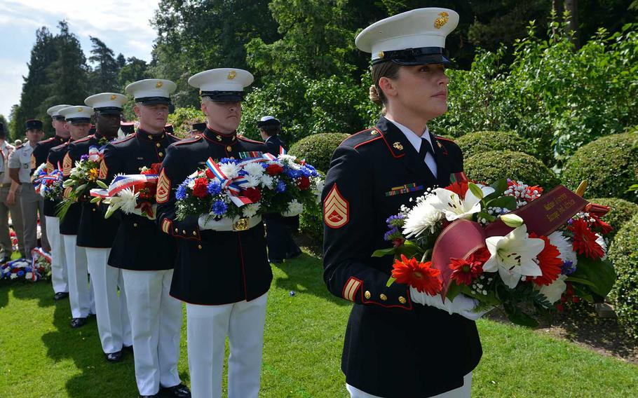 A line of Marines hold wreaths they were to present for laying during the Memorial Day ceremony at Aisne-Marne American Cemetery in Belleau, France. The ceremony also commemorated the World War I centennial.