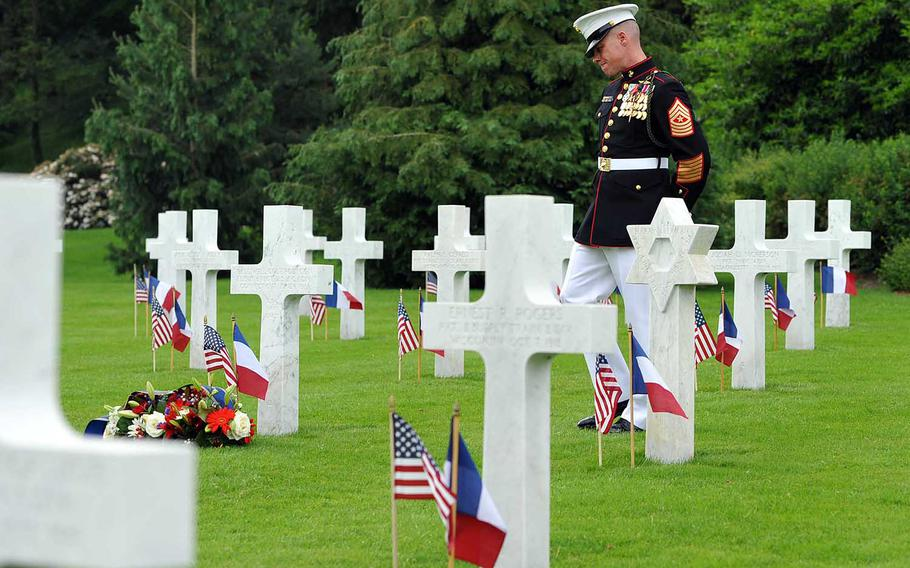 Marine Sgt. Maj. Darrell Carver, 6th Marine Regiment, walks through the graves at Aisne-Marne American Cemetery in Belleau, France. American and French marked Memorial Day and the centennial of the World War I Battle of Belleau Wood with a ceremony at the cemetery.