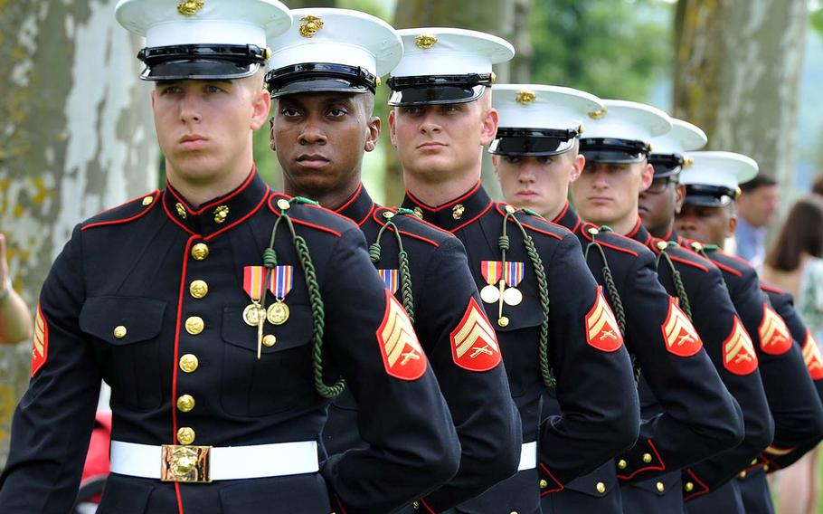 The 6th Marines Firing Detail stand in formation before the start of the Memorial Day ceremony at Aisne-Marne American Cemetery in Belleau, France.