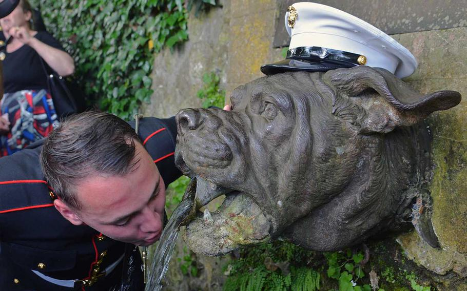 Marine Cpl. Alexander Sturdiviant drinks from the famed Bulldog fountain at Belleau, France, following a Memorial Day Ceremony at Aisne-Marne American Cemetery, Sunday, May 27, 2018. Sturdiviant is attached to 1st Battalion, 6th Marines Black Sea Rotation. Drinking from the fountain is a Marine ritual.