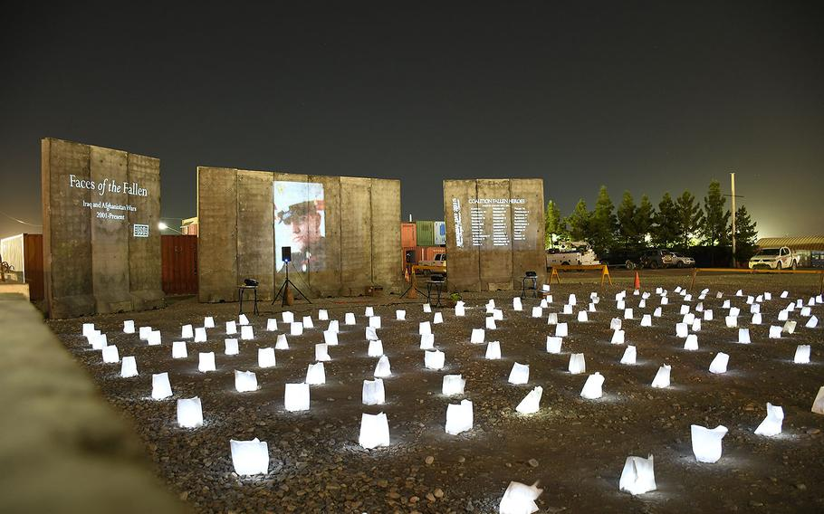 A field of 500 luminary lights and a display of images, names and videos of the U.S. troops who have died in America's post-9/11 wars was set up on Memorial Day, Monday, May 28, 2018, at a site near the Bagram Air Field PX in Afghanistan.