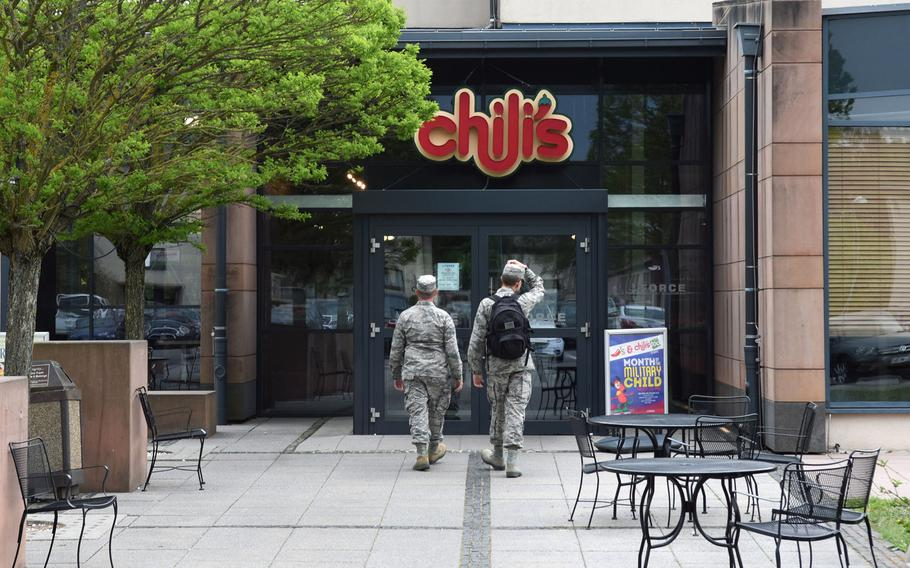 Airmen walk into Chili's at Ramstein Air Base, Germany, on April 25, 2018. Chili's is among the establishments on base that employs third-country nationals. Their employment status recently changed; now they fall under the host nation, non-U.S. employment program.