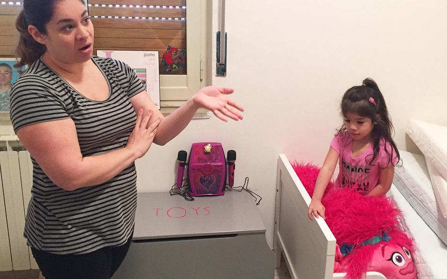 Jessica Alaniz talks about how a test kit she bought detected lead in this bedroom, where her two youngest daughters, Jizelle, 4, right, and Audrianna, 2, sleep. She is concerned about the apartment's cracks and flaking paint, which health experts say increases risks to children.