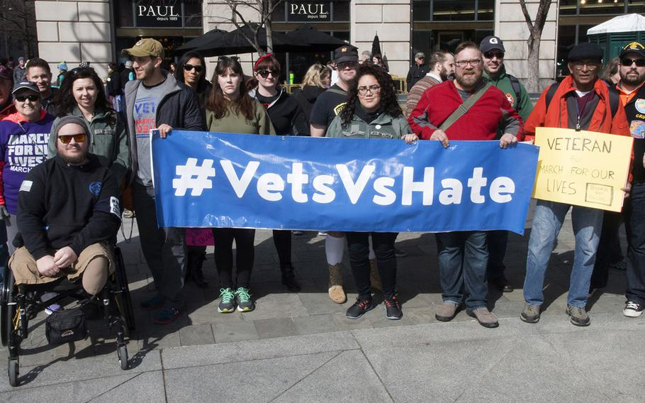 Veterans pose for a photo at the March for Our Lives in Washington, D.C. on March 24, 2018. Military veterans have joined up with Everytown for Gun Safety, the country's largest gun control advocacy organization, to form a veterans advisory council.