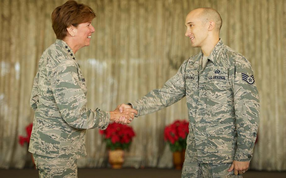 U.S. Air Force Gen. Lori J. Robinson, Pacific Air Forces commander, congratulates Staff Sgt. Ryan Sofranko on his selection for promotion to technical sergeant through the Stripes for Exceptional Performers program during a Headquarters PACAF all-call, Jan. 8, 2016, Joint Base Pearl Harbor-Hickam, Hawaii.