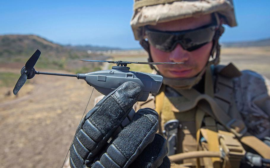 Lance Cpl. Cesar Salinas, an infantry Marine with 3rd Battalion, 5th Marine Regiment, displays the PD-100 Black Hornet after an exercise on Camp Pendleton, Calif., July 9, 2016.