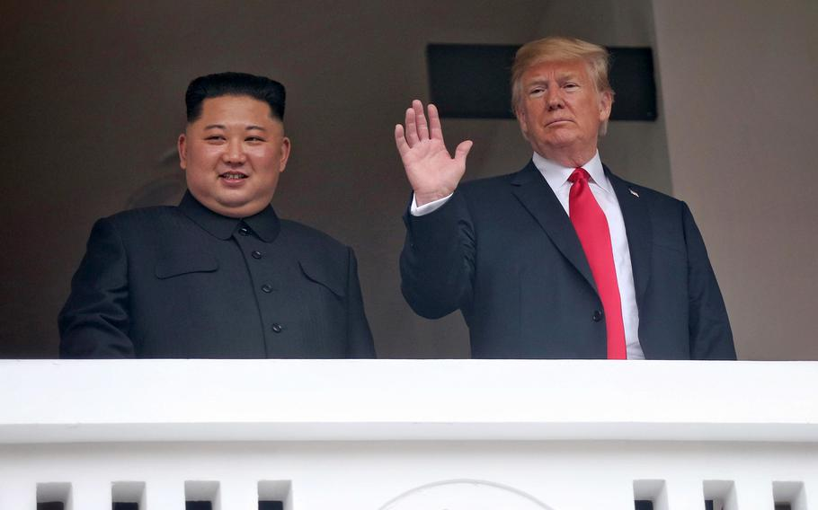 President Donald Trump and North Korean leader Kim Jong Un wave to the media during their meeting in Singapore on June 12, 2018.