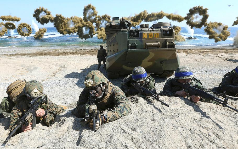 U.S. and South Korean servicemembers take positions after landing on a beach during a joint military combined amphibious exercise, called Ssangyong, part of the Key Resolve and Foal Eagle military exercises, in Pohang, South Korea, on March 12, 2018.
