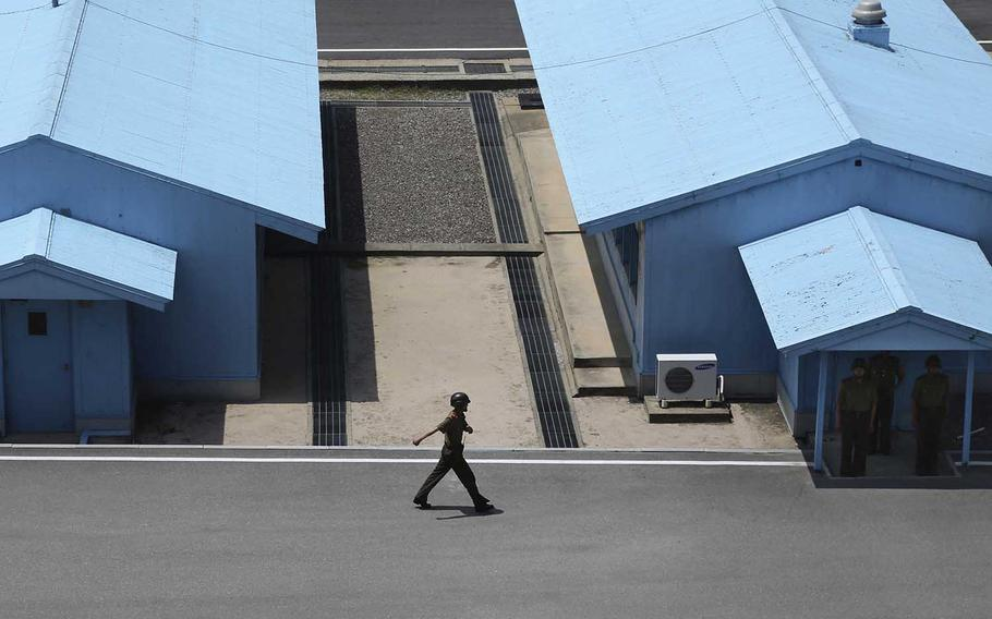A North Korean soldier marches at the truce village at the Demilitarized Zone, which separates the two Koreas in Panmunjom, North Korea, Wednesday, June 20, 2018.