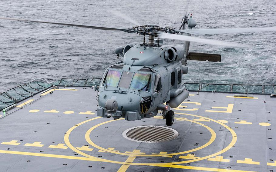 A helicopter takes off from a Norwegian naval ship on June 29, 2018, on the north Atlantic near Norway for Dynamic Mongoose. The two-week NATO maritime exercise is aimed at improving allied nations' anti-submarine warfare.