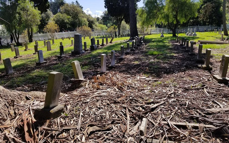 The Mare Island Naval Cemetery, the oldest military graveyard on the West Coast, is in dilapidated conditions. The landscape of the Vallejo, Calif., graveyard is marked by patches of grass, weeds and piles of bark. Some 19th century headstones are falling and held up by logs. Stone work throughout the site is crumbling. A white picket fence that has darkened over time is falling.