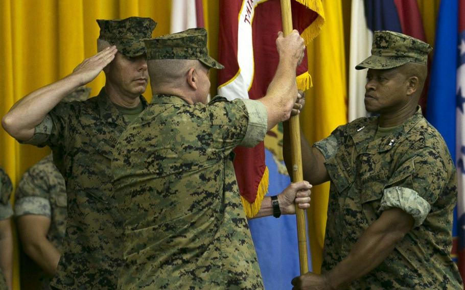 Brig. Gen. Craig Q. Timberlake, the commanding general of 3rd Marine Division, relinquishes command to Brig. Gen. William M. Jurney during a change-of-command ceremony on Camp Courtney, Okinawa,  July 6, 2018.