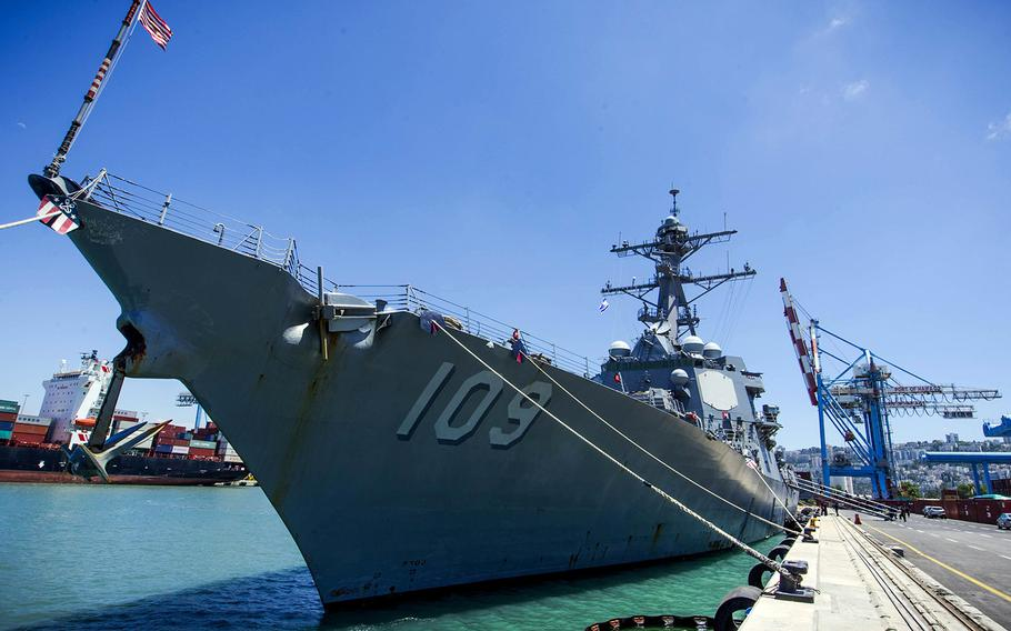 In a June 19, 2018 file photo, the guided-missile destroyer USS Jason Dunham is moored at the pier in Haifa, Israel, during a scheduled port visit.