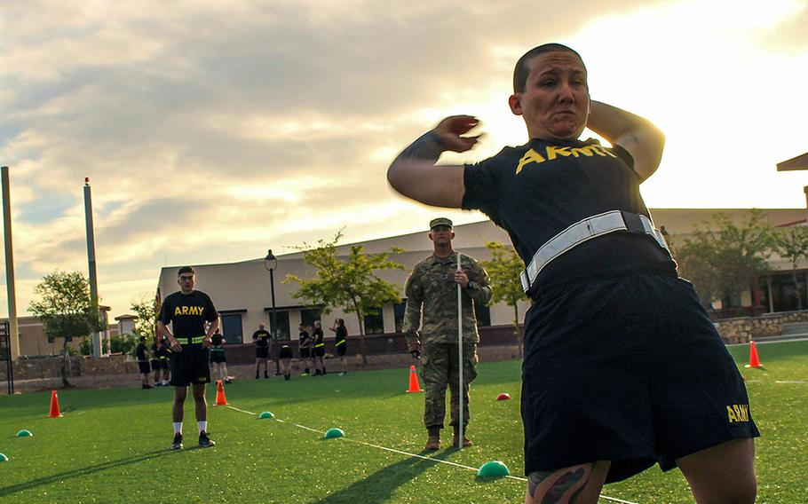 Spc. Shelbi Constancio, assigned to Headquarters Company, 150th Engineer Battalion, completes a backwards power throw during a pilot program for the Army Combat Fitness Test at Fort Bliss, Texas, April 17, 2018.