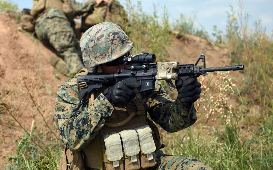 A U.S. Marine provides security for machinegunners while training with Ukrainian marines during Exercise Sea Breeze, Thursday, July 12, 2018.