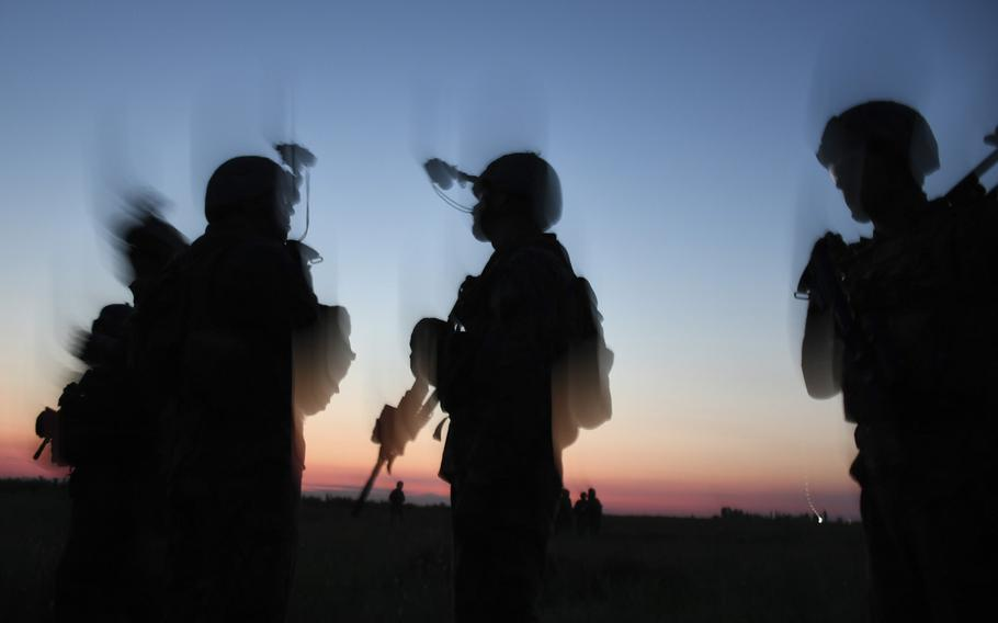 A group of U.S. Marines from Weapons Platoon, Echo Company, 2nd Battalion, 25th Regiment prepare for a night patrol and ambush drill at a military base near the southern Ukrainian city of Mykolaiva, about 100 miles from the Russian-occupied Crimean Peninsula, during Exercise Sea Breeze on Thursday, July 12, 2018.